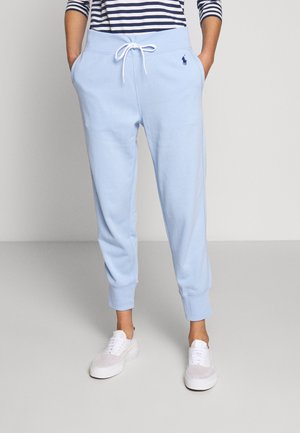 FEATHERWEIGHT - Tracksuit bottoms - elite blue