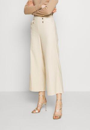 PALA - Trousers - banana