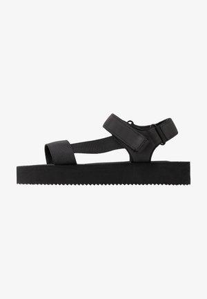 SPRINGY - Sandalias con plataforma - black