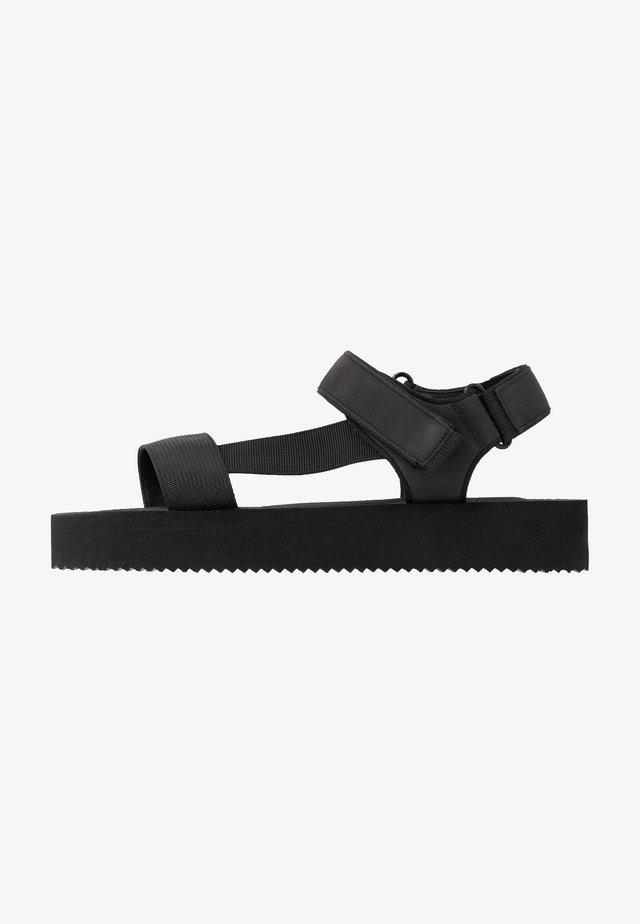 SPRINGY - Sandalen met plateauzool - black