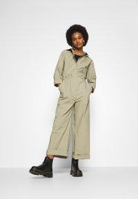 Nike Sportswear - COVERALL - Jumpsuit - mystic stone - 1