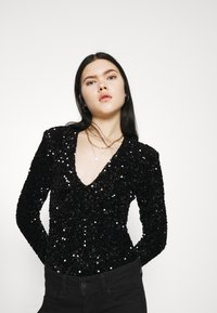 Good American - STRETCH SEQUINS - Long sleeved top - black - 3