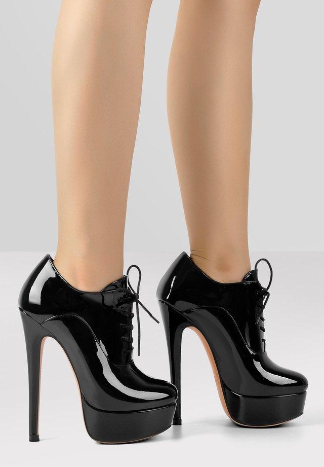 High heeled ankle boots - metallic black