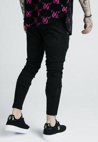 SIKSILK - X DANI ALVES PRESTIGE - Slim fit jeans - black - 2