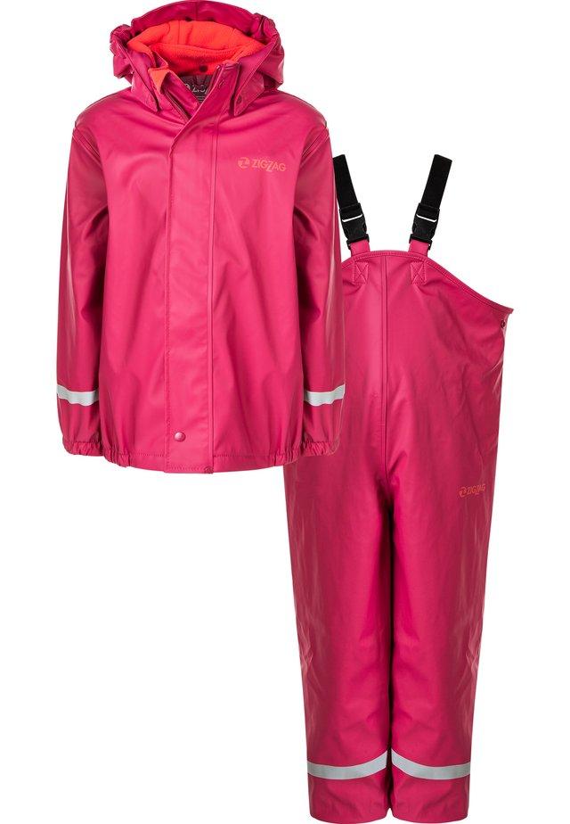 CRAMER - Rain trousers - 4008 cerise