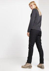 Jack Wolfskin - WINTER TRAVEL PANTS WOMEN - Pantaloni outdoor - black - 2