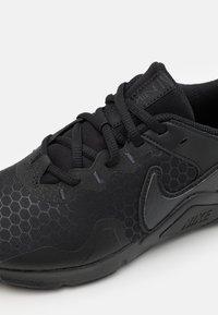 Nike Performance - LEGEND ESSENTIAL 2 - Zapatillas de entrenamiento - black/off noir - 5
