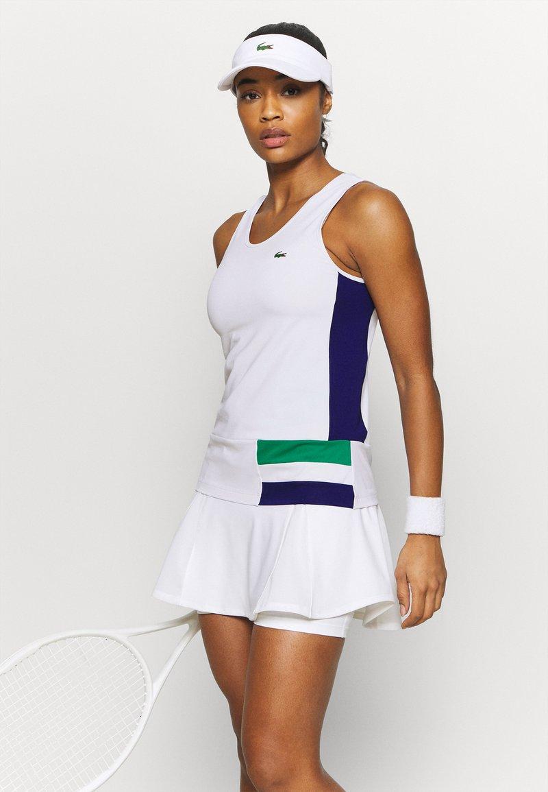 Lacoste Sport - TENNIS TANK - Sports shirt - white/cosmic greenfinch/black