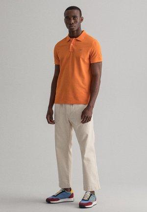Polo shirt - russet orange