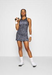 Nike Performance - DRY SKIRT - Sports skirt - black/white - 1