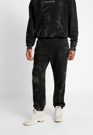 CRACKED PANT - Tracksuit bottoms - black