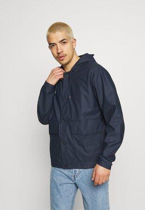SHORT HOODED COAT UNISEX - Waterproof jacket - blue