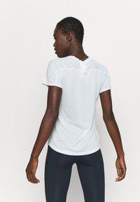 New Balance - IMPACT RUN - Camiseta básica - camdnfog - 2