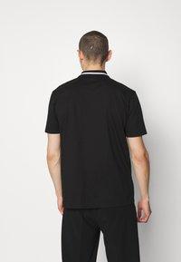 HUGO - DOLMAR - Polo shirt - black - 2
