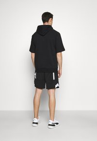 Champion - HOODED SHORT SLEEVES - Sweatshirt - black/white - 2