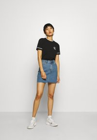 Calvin Klein Jeans - EMBROIDERY TIPPING TEE - Print T-shirt - black - 1