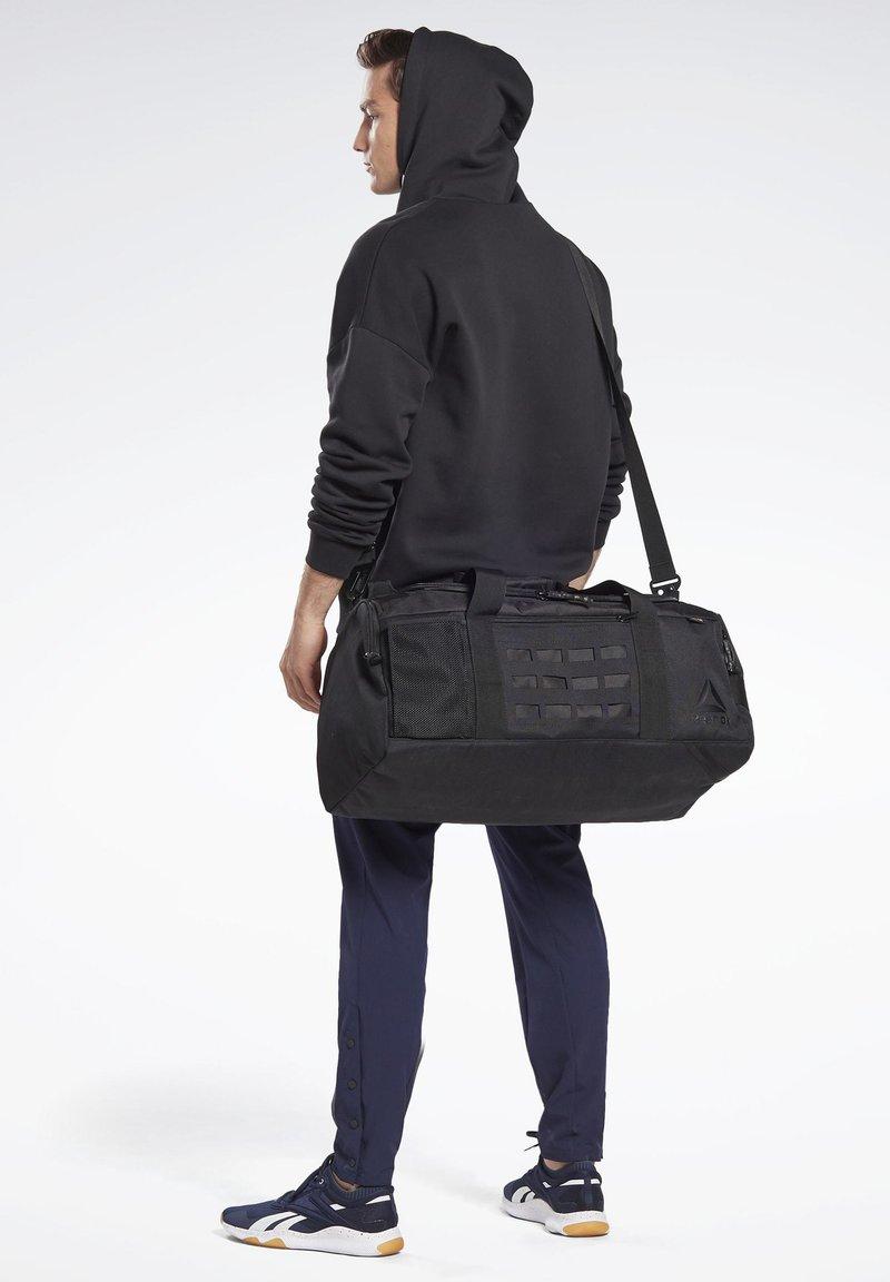 Reebok - TRAINING GRIP DUFFLE BAG - Sports bag - black