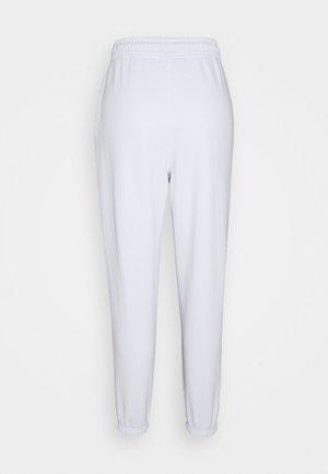 OVERSIZED 90S - Tracksuit bottoms - white
