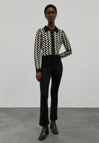 EDITED - BRIDGET - Trousers - schwarz - 0