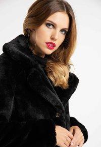 faina - Winter coat - black - 3