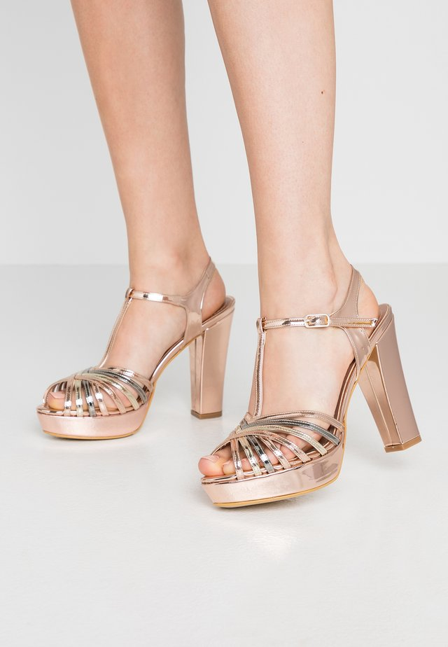 High heeled sandals - copper