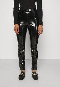 ONLY Tall - ONLTASSIE SHINY - Pantalones - black - 0
