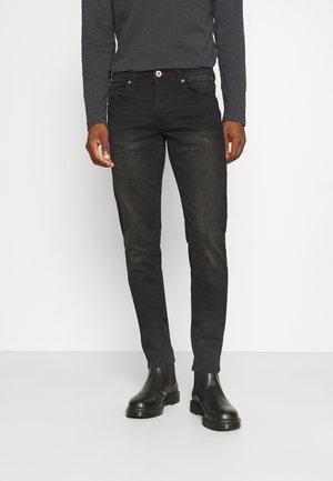 RUSSEL - Slim fit jeans - black stone