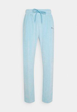 TRACK PANTS UNISEX - Teplákové kalhoty - skyblue
