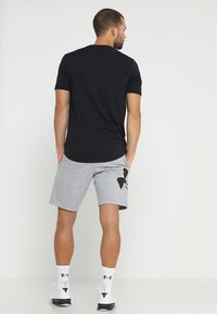 Under Armour - RIVAL LOGO SHORT - Urheilushortsit - steel light heather/black - 2