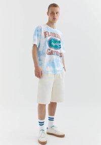 PULL&BEAR - FLORIDA GATORS - Print T-shirt - light blue - 1