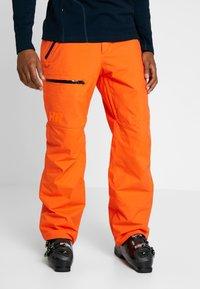 Helly Hansen - SOGN - Snow pants - bright orange - 0