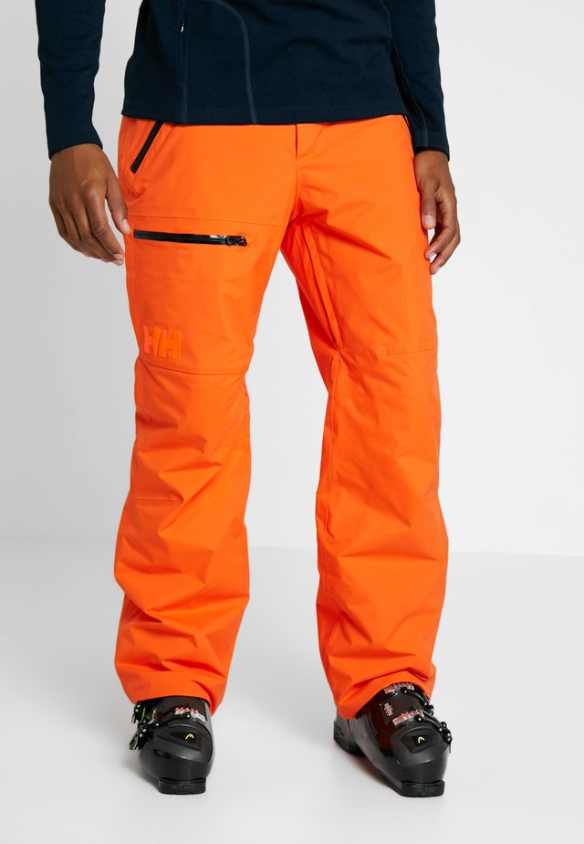 SOGN CARGO PANT - Pantalon de ski - bright orange