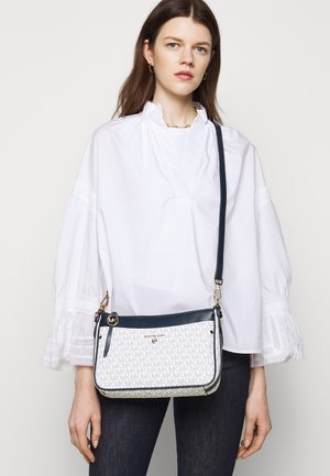 JET CHARM POCHETTE XBODY - Handbag - white/navy