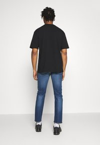 Levi's® - 502™ TAPER - Slim fit jeans - smoke stacked adv - 2