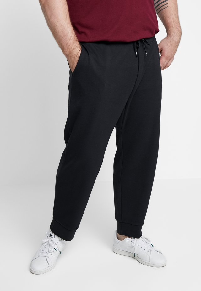 DOUBLE KNIT TECH - Tracksuit bottoms - polo black