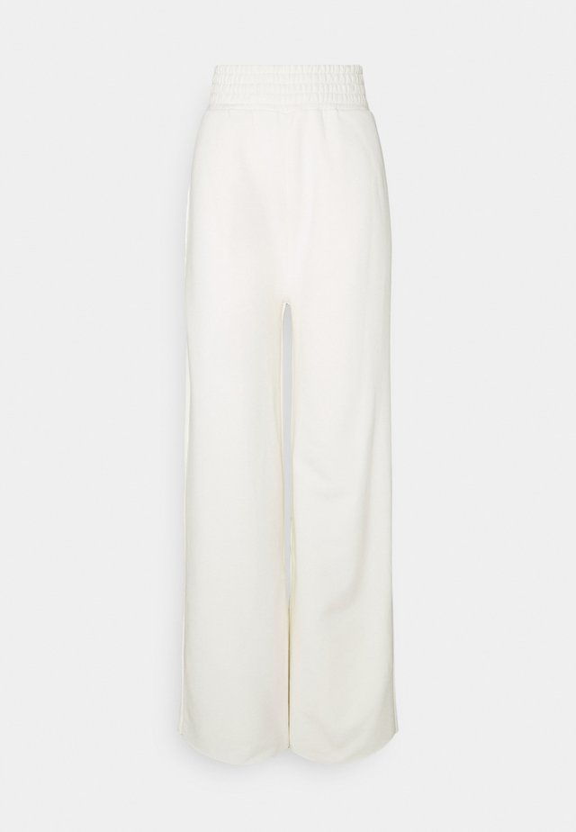 K AND K FLARE HIGH RISE - Pantaloni sportivi - off white