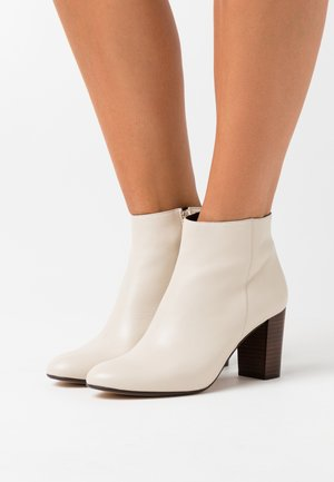 AULINAKA - Classic ankle boots - ivoire