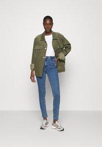 Calvin Klein Jeans - HIGH RISE SKINNY - Skinny džíny - blue - 1