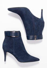 Calvin Klein - GITAR - High heeled ankle boots - dark navy - 3
