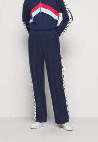 CECILIE copenhagen - JUTTA - Trousers - navy - 0