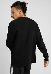 Carhartt WIP - BASE - T-shirt à manches longues - black/white - 2