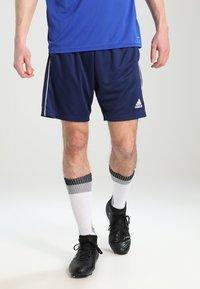 adidas Performance - CORE ELEVEN PRIMEGREEN FOOTBALL 1/4 SHORTS - Krótkie spodenki sportowe - dark blue/white - 0