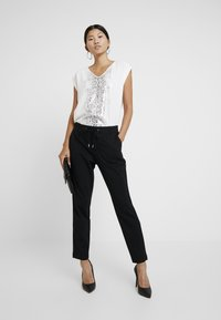 s.Oliver - SMART - Trousers - black - 1