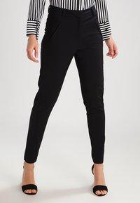 Vero Moda - VMVICTORIA - Spodnie materiałowe - black - 0