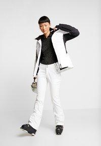 Kjus - WOMEN DUANA JACKET - Ski jacket - white/black - 1