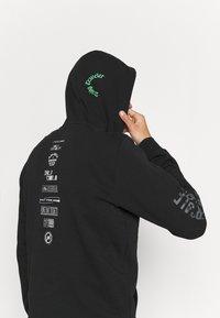 adidas Performance - X CITY HOODY - Sweatshirt - black - 4