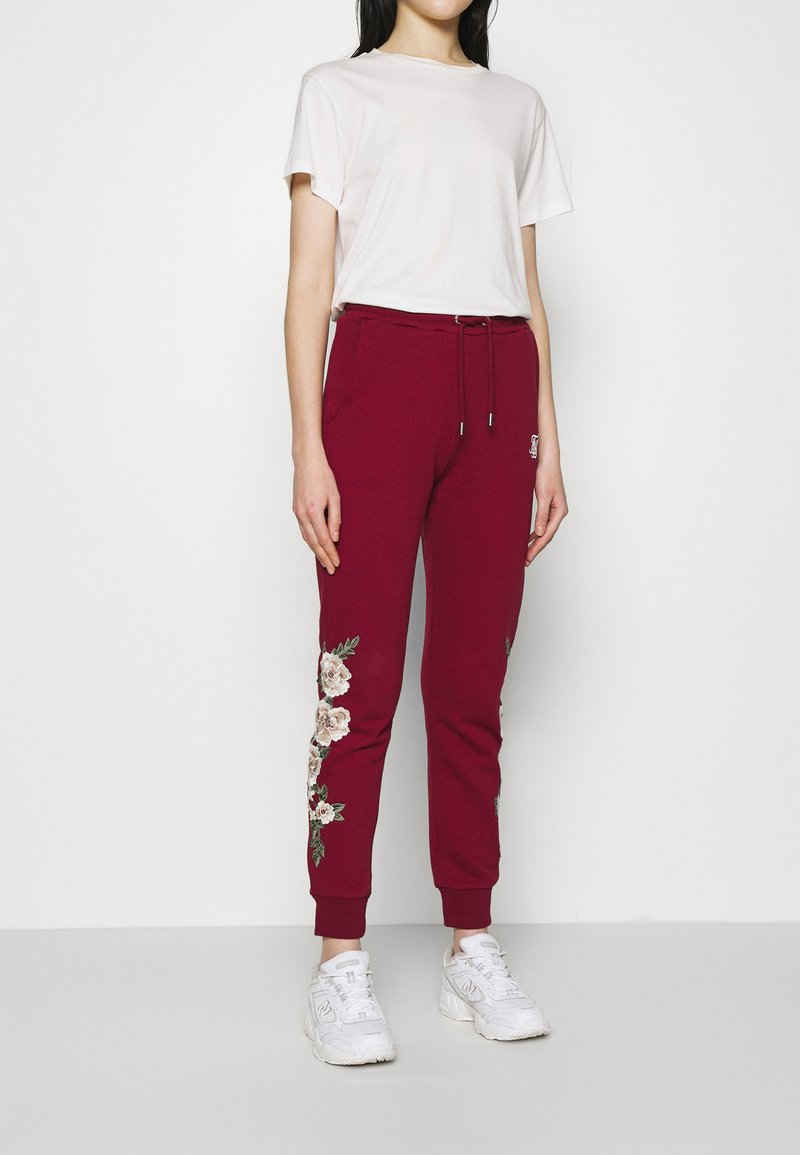 SIKSILK - FLORAL EMBROIDERED JOGGERS - Tracksuit bottoms - burgundy