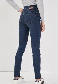 Cache Cache - MIT HOHER TAILLE - Slim fit jeans - denim blue black - 2