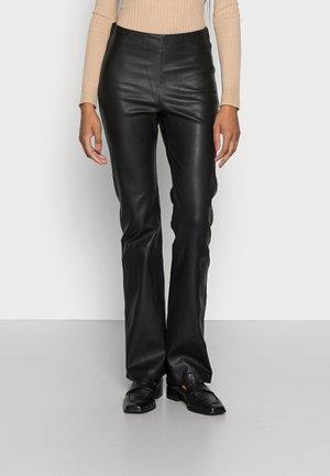 CEDAR LONG PANTS - Leather trousers - black