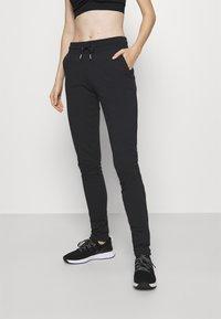 Fila - KARLA - Teplákové kalhoty - black - 0